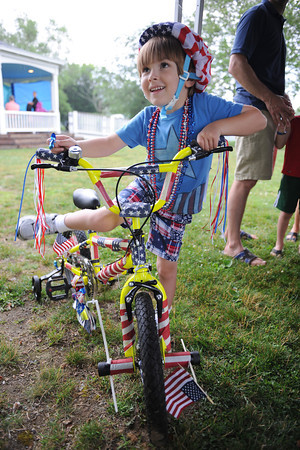 Manchester: Cole Cote 4, of Manchester, mounts his bike after signing in at the Bike Parade held Sunday afternoon at Masconomo Point. Desi Smith/Gloucester Daily Times. July 2,2011.