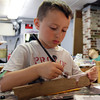 David Le/Gloucester Daily Times. Beckham Hughes, 6, of Killingworth, CT, paints the side of his art board at the Rockport Art Association's Garden Sculpture workshop on Tuesday. 7/12/11.