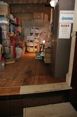 ALLEGRA BOVERMAN/Staff photo. Gloucester Daily Times. Essex: The Planning Board office in the Essex Town Hall is tucked in what was a dressing room off the stage. Steep steps go up the stage. There is storage for other departments on the stage.
