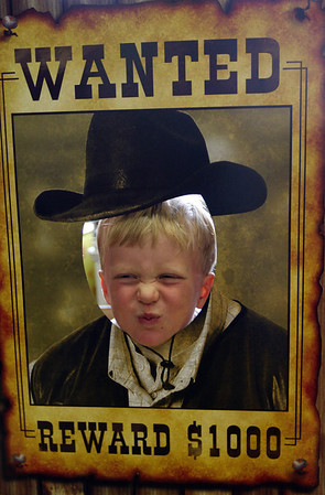 "ALLEGRA BOVERMAN/Staff photo. Gloucester Daily Times. Essex:<br /> Samuel Appleyard, 4, makes a saucy face during the Wild West Fest at the Essex Library on Tuesday. There were many western-themed activities and crafts including making sheriff's badges out of cookies, lasso the cowboy boots, archery and pony rides. Special foods included ""cactus"" punch, beef jerky, trail mix and biscuits and jam."