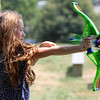 "ALLEGRA BOVERMAN/Staff photo. Gloucester Daily Times. Essex:  Eden Mayer, 9, practices archery during the Wild West Fest at the Essex Library on Tuesday. There were many western-themed activities and crafts including making sheriff's badges out of cookies, lasso the cowboy boots, archery and pony rides. Special foods included ""cactus"" punch, beef jerky, trail mix and biscuits and jam."