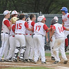 Gloucester: Gloucester players celebrate Cody Burkes 2nd inning homerun, one of the bright spots in Saturday night 13-3 loss to Danvers in the Distict 15 Championship Saturday night at Harry Ball Field in Beverly. Jim Vaiknoras/staff photo