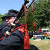 ALLEGRA BOVERMAN/Staff photo. Gloucester Daily Times. Gloucester: Firefighters and police were on hand at the funeral for Gloucester Firefighter Michael E. Smith at Doliver's Memorial Cemetery on Wednesday morning. Gloucester firefighter Jeffrey Romeo played bagpipes during the graveside ceremony.