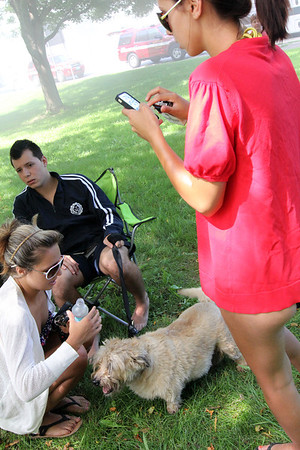 ALLEGRA BOVERMAN/Staff photo. Gloucester Daily Times. Gloucester: Vanessa Cardone,  right, and her brother Steven Cardone, 17, seated, with their dog, Monty, after a fire ripped through their home at 2 Ashland Place on Monday afternoon. Their rabbit and another dog were also rescued.