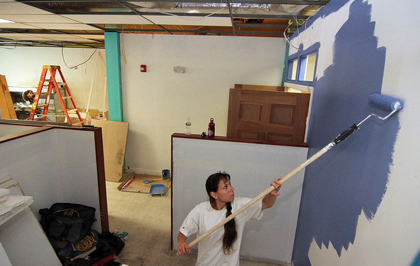 ALLEGRA BOVERMAN/Staff photo. Gloucester Daily Times. Gloucester: Volunteer Donna Therrien paints the area where she and the other members of Tri Art Studio will have workspace inside the new Hive community arts center on Pleasant Street.