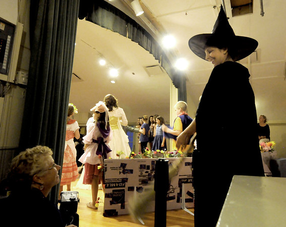 """Gloucester: Gina Milne as the Wicked Witch of the West talks with Val Gilman as she waits for her que in the  Annisquam Village Players production of """"THe Wizard of Oz. Jim Vaiknoras/staff photo"""