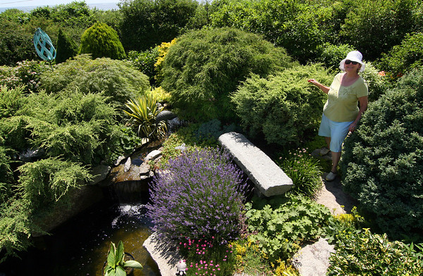 ALLEGRA BOVERMAN/Staff photo. Gloucester Daily Times.Rockport:<br /> Gretchen Anderson in her 5 Witham Road garden on Thursday. Her gardens are on the Coastal Gardens tour on Friday and Satuday in Rockport. A luncheon and art sale will be held at her home's grounds as well.