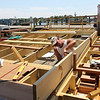 ALLEGRA BOVERMAN/Staff photo. Gloucester Daily Times. Gloucester: The Harborwalk area at the I-4, C-2 site is still under construction. A boardwalk with a built-in ramp is being built there. Dave Mason works there on Thursday.