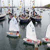 Marjorie Nesin/Staff photographer. Gloucester Daily Times. Rockport: A group of 8 and 9-year-olds, in their third week of sailing at Sandy Bay Yacht Club, sail by the moored Naval Academy boats as they arrived on Friday morning to Rockport for the weekend.