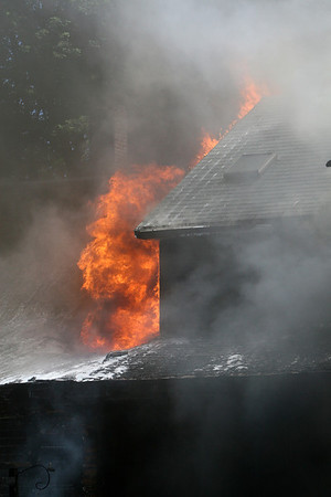 ALLEGRA BOVERMAN/Staff photo. Gloucester Daily Times. Gloucester: This two-family home at 2 Ashland Place sustained a two-alarm fire on Monday afternoon.