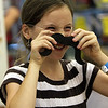 "ALLEGRA BOVERMAN/Staff photo. Gloucester Daily Times. Essex:  Maggie Gould, 8, tries on a moustache during the Wild West Fest at the Essex Library on Tuesday. There were many western-themed activities including making sheriff's badges out of cookies, lasso the cowboy boots, archery and pony rides. Special foods included ""cactus"" punch, beef jerky, trail mix and biscuits and jam."