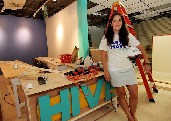 ALLEGRA BOVERMAN/Staff photo. Gloucester Daily Times. Gloucester: Dawn Gadow, the executive director of Cape Ann Art Haven, in the computer lab area of the new Hive community arts center on Pleasant Street.