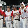ALLEGRA BOVERMAN/Staff photo. Gloucester Daily Times. Beverly: Gloucester American players are ready to congratulate teammate Jon Jon Mondello, far left, as he crosses home plate during their game against Danvers American on Friday night in Beverly.