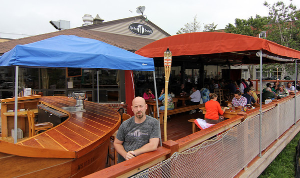 ALLEGRA BOVERMAN/Staff photo. Gloucester Daily Times. Gloucester: Jeremy Goldberg, owner of Cape Ann Brewing Co. has applied for a permit for his awning, right, so that it can be closed on three sides.