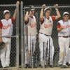 Gloucester: Players in the Gloucester dugout look on as their team goes down 13-3 to Danvers in the Distict 15 Championship Saturday night at Harry Ball Field in Beverly. Jim Vaiknoras/staff photo