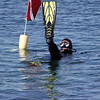 ALLEGRA BOVERMAN/Staff photo. Gloucester Daily Times. Rockport: A scuba diver floats in the water before submerging off Old Garden Beach in Rockport on Thursday afternoon.
