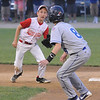 Gloucester: Gloucester's Eric Chalmers catches Danver's Tim Usalis in a rundown during Gloucester's 13-3 loss to Danvers in the Distict 15 Championship Saturday night at Harry Ball Field in Beverly. Jim Vaiknoras/staff photo