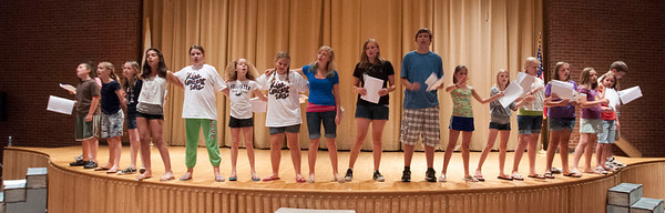 "Gloucester: Students in the O'Maley Middle School Performing Arts Dept. Drama Camp sing John Lennon's Imagine as they rehearse for their show ""Us and Them"" which will be performed Friday free of charge at the school. Jim Vaiknoras/staff photo"