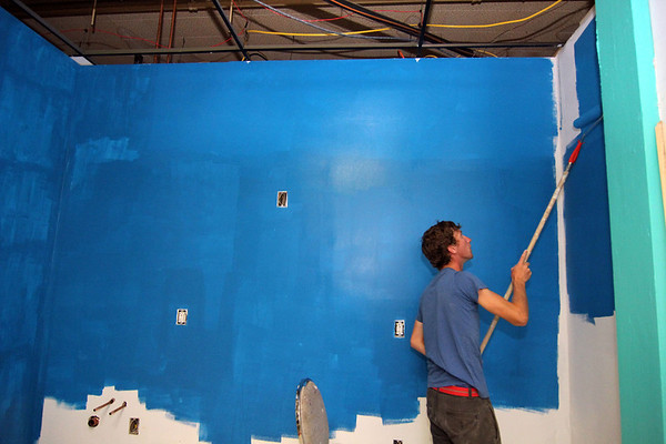 ALLEGRA BOVERMAN/Staff photo. Gloucester Daily Times. Gloucester: Volunteer Ian Richards paints in the new art classroom inside the new Hive community arts center on Pleasant Street.