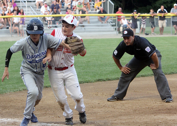 ALLEGRA BOVERMAN/Staff photo. Gloucester Daily Times. Beverly: Sal Costanzo, at third base for Gloucester American, tussles with Danvers American player Tim Usalis during their game in Beverly on Friday night.