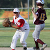 ALLEGRA BOVERMAN/Staff photo. Gloucester Daily Times. Ipswich: The Gloucester Americans team won their game against Danvers National 6-4 in the District 15 Williamsport Pool Play on Monday afternoon. Gloucester's Mark Smith, left, and Danvers' Brynn O'Neill at second base.