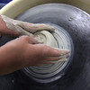 ALLEGRA BOVERMAN/Staff photo. Gloucester Daily Times. Gloucester: Aidan Cunningham, a sixth grader, from Gloucester, learns how to throw clay on a wheel at Art Haven during Clay Week. Susan Hershey, a potter from Rockport, was the guest artist teaching children how to make various kinds of pottery. Next week, Art Haven will team up with Maritime Gloucester for a week of projects at both locations. Call 978-283-3888 for more information.