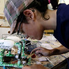 ALLEGRA BOVERMAN/Staff photo. Gloucester Daily Times. Gloucester: Diane Story, an incoming O'Maley Middle School sixth grader, works on her remote-operated vehicle, or ROV, a submersible, that she is building at Maritime Gloucester on Thursday afternoon. She is among 40 students who are taking part in the two-week long Summer Engineering Adventure, which is a partnership of Maritime Gloucester, MIT's Edgerton Center, the Gloucester Education Foundation and O'Maley Middle School. The students rotate between projects in Gloucester at Maritime Gloucester and on the Cambridge campus.