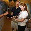 ALLEGRA BOVERMAN/Staff photo. Gloucester Daily Times. Gloucester: Laura Howes, left, of the Whale Center, talks about baleen with Anthony and Karen of Melrose, visiting for the day on Thursday. The Whale Center of New England reopened in mid-June.