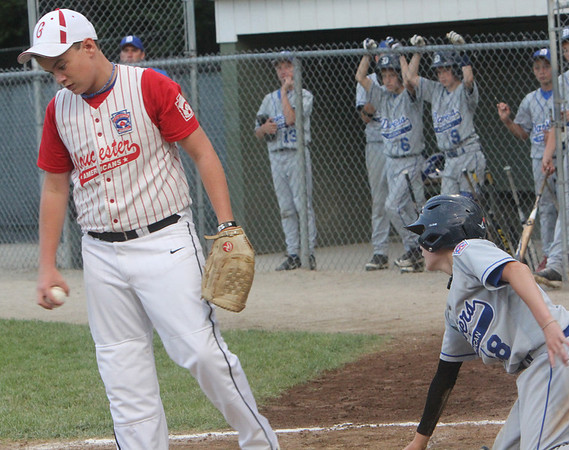 ALLEGRA BOVERMAN/Staff photo. Gloucester Daily Times. Beverly: Gloucester American pitcher Will Moore reacts after Danvers player Tim Usalis is safe at home plate during their game against Danvers American on Friday night in Beverly.