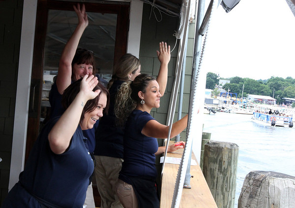 "ALLEGRA BOVERMAN/Staff photo. Gloucester Daily Times. Essex: Riverside Bistro is now open in Essex. The waitstaff wave four times a day with a ""bobblehead queen wave"" from the restaurant's deck as the Essex River Cruises boat goes by."