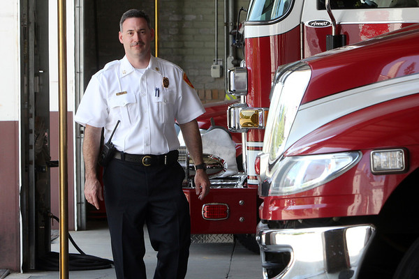 ALLEGRA BOVERMAN/Staff photo. Gloucester Daily Times. Gloucester: Eric Smith on his first day as fire chief in the Gloucester Fire Department.