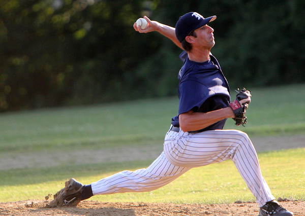 ALLEGRA BOVERMAN/Staff photo. Gloucester Daily Times. Essex: Manchester's Rusty Tucker pitches against Rowley during an ITL game held in Essex on Tuesday evening.