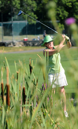 Gloucester: Judy Krzynowek tees off on the 1st hole at the Bass Rocks Club Championship Sunday morning. Jim vaiknoras/staff photo