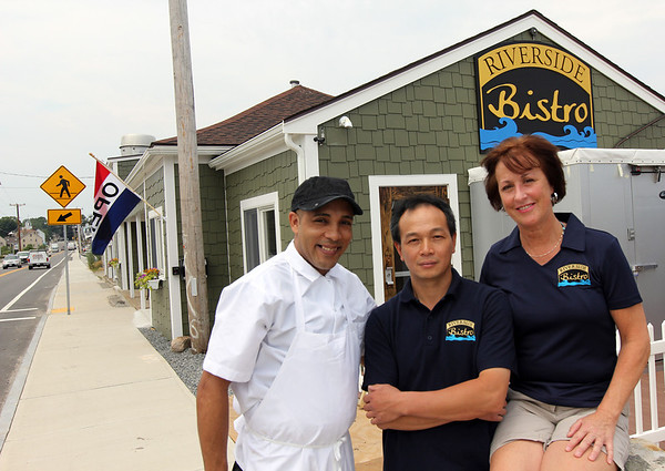 ALLEGRA BOVERMAN/Staff photo. Gloucester Daily Times. Essex: Riverside Bistro is now open in Essex. From left are chef Valci Da Silva, owner Bing Gao and manager Carole McNair.