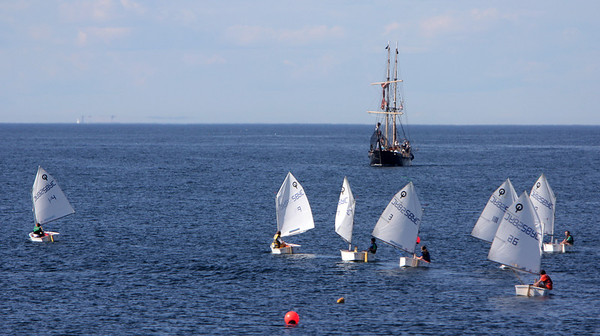ALLEGRA BOVERMAN/Staff photo. Gloucester Daily Times. Rockport: A sailing class scoots around while The Formidable pirate ship floats nearby on Thursday afternoon off Rockport seen from Old Garden Beach.