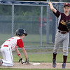 ALLEGRA BOVERMAN/Staff photo. Gloucester Daily Times. Ipswich: The Gloucester Americans team won their game against Danvers National 6-4 in the District 15 Williamsport Pool Play on Monday afternoon. Gloucester's Jake Horrigan, left, is safe on third base. Danvers' Tim Galvin is at right.