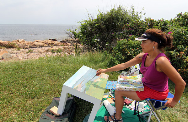 ALLEGRA BOVERMAN/Staff photo. Gloucester Daily Times. Gloucester: <br /> Pathways has commissioned 16 local artists to transform Parsons-style tables into colorful and vibrant works of art. The one-of-a-kind tables, which will be ready for public display by September, will be auctioned at a gala event at Cruiseport on November 9, 2012 to benefit Pathways' programs for children. On Wednesday, artist Loren Doucette of Gloucester paints a scene Along Atlantic Road in view of Twin Lights and Thacher Island.