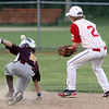 ALLEGRA BOVERMAN/Staff photo. Gloucester Daily Times. Ipswich: The Gloucester Americans team won their game against Danvers National 6-4 in the District 15 Williamsport Pool Play on Monday afternoon. Gloucester's Jake Horrigan, right, and Danvers' Dom Colella in action at second plate.