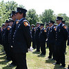 ALLEGRA BOVERMAN/Staff photo. Gloucester Daily Times. Gloucester: Firefighters and police were on hand at the funeral for Gloucester Firefighter Michael E. Smith at Doliver's Memorial Cemetery on Wednesday morning.