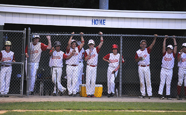 Beverly:  Gloucester player watch from the dugout as their team gets behind early to Manchester during their game at Harry Ball Field in Beverly. Jim Vaiknoras/staff photo