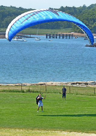 Gloucester: Alex Coura visiting from Brazill practices handling his paraglider at Stage Fort Park. Alex has been paragliding for about six  months.  Desi Smith/Gloucester Daily Times.