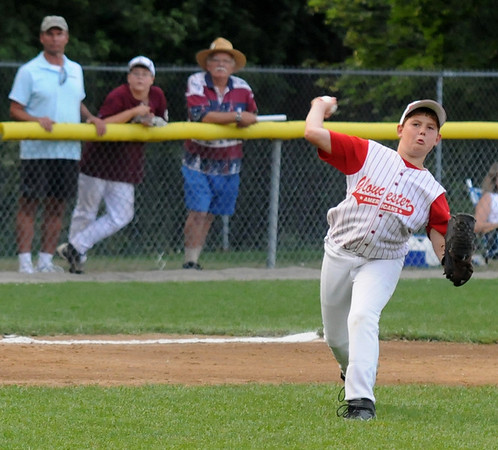 Gloucester: Gloucester's Evan Leaf makes a throw to first during Gloucester's 13-3 loss to Danvers in the Distict 15 Championship Saturday night at Harry Ball Field in Beverly. Jim Vaiknoras/staff photo