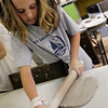 ALLEGRA BOVERMAN/Staff photo. Gloucester Daily Times. Gloucester: Bailey Marshall, a sixth grader from Gloucester, rolls out clay to create a pizza piece on Friday during Art Haven's Clay Week on Friday. Next week Art Haven will team up with Maritime Gloucester for a week of projects at both locations. Call 978-283-3888 for more information.