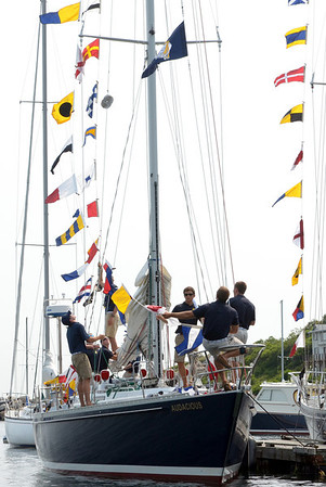 Marjorie Nesin/Staff photographer. Gloucester Daily Times. Five Rockport: Naval Academy ships arrived in Rockport early Friday morning for a weekend stay. Midshipmen cover the sails and hoist flag pennants, in preparation to exit the boats.