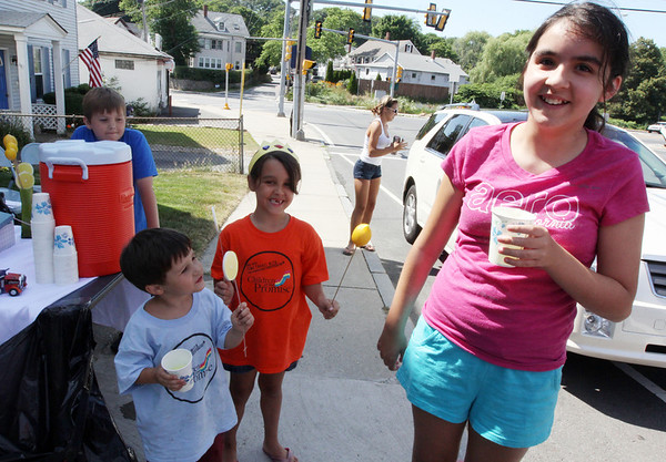 ALLEGRA BOVERMAN/Staff photo. Gloucester Daily Times. Gloucester: Bailee Militello, 6, center, of 29 East Main Street, was holding a lemonade stand at her house on Wednesday afternoon to benefit the Cardone family of 2 Ashland Place who had a big fire at their home on Monday. The lemonade sale will continue on Thursday from 2:30 - 4:30 p.m. Family friend Rhiannon Jensen, 12, far right, samples the lemonade. Bailee's brother Jimmy, 2, is at lower left, and neighbor Jason Gleason, 9, far left, was helping.