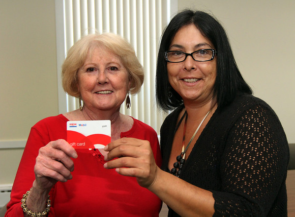 "ALLEGRA BOVERMAN/Staff photo. Gloucester Daily Times. Gloucester:  Patricia Davidsen-Craft, left, of Gloucester, won the $500 ""Free"" Gas Giveaway. Christine Madruga of Circulation presented her with the card."