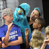 "Allegra Boverman/Staff photographer. Gloucester Daily Times. Gloucester: Roxie Myhrum, artistic director of the Puppet Showplace Theatre of Brookline, center, with her puppet, Bartok, gave a puppeteering workshop at the Gloucester Stage Company's Youth Acting Workshops on Friday. She also coached the actors in the GSC's current production of ""Carnival."" From left to right in front of her are workshop participants Mark Turner, left, 12, and Brandon Bruce, 11."