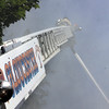 ALLEGRA BOVERMAN/Staff photo. Gloucester Daily Times. Gloucester: at Firefighters attacked the fire at 2 Ashland Place from above, using the ladder truck, Monday afternoon in Gloucester.