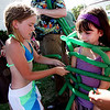 "ALLEGRA BOVERMAN/Staff photo. Gloucester Daily Times. Rockport: Sarah Patey, 6, of Rockport, far right, gets tied up during the ""vine wrap"" game with balloons during Jungle Jim's Balloons, an event held by the Friends of the Rockport Library on Tuesday afternoon at the Legion Bandstand area on Beach Street. The program was part of the ""Dream Big - Read"" summer reading program. Jungle Jim played balloon games  performed magic tricks and told stories. From left are Anna Drost, 6, and Jane Reilly, 8, both of Rockport."