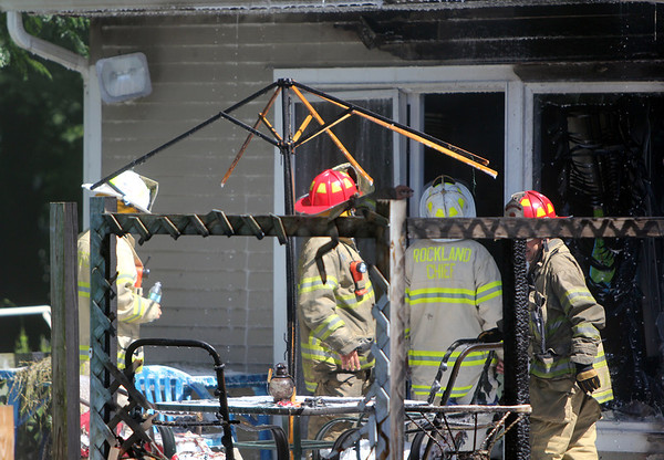 ALLEGRA BOVERMAN/Staff photo. Gloucester Daily Times. Gloucester: Acting Fire Chief Robert A. DiPoli, center, wearing Rockland Chief turnout gear, confers with firefighters at the scene of a fire at 2 Ashland Place in Monday afternoon in Gloucester.